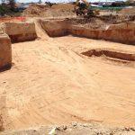 Large detailed excavation using loader and excavator with rock grinder
