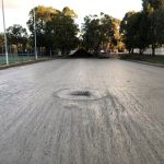 Tennis court car park water bound levelled and compacted with soak well installed ready for asphalt